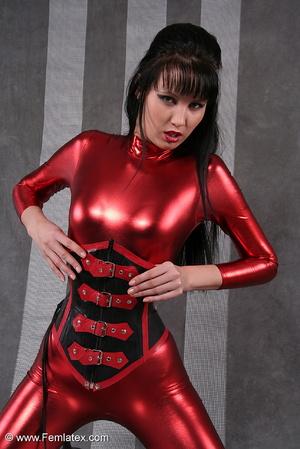 Seductive brunette babe in red latex jum - XXX Dessert - Picture 12