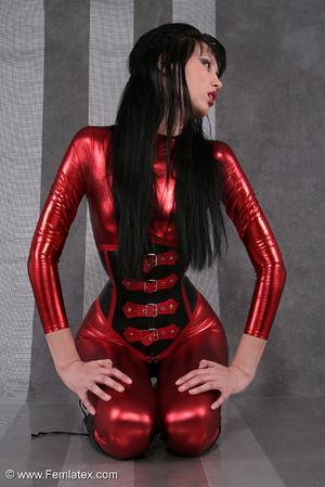 Seductive brunette babe in red latex jum - XXX Dessert - Picture 14
