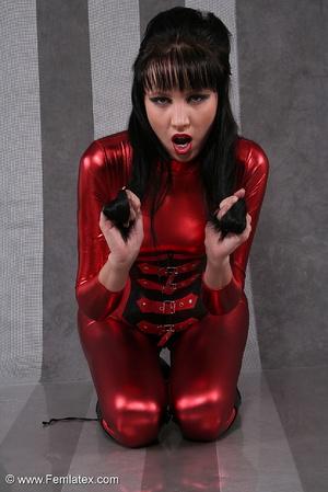 Seductive brunette babe in red latex jum - XXX Dessert - Picture 16