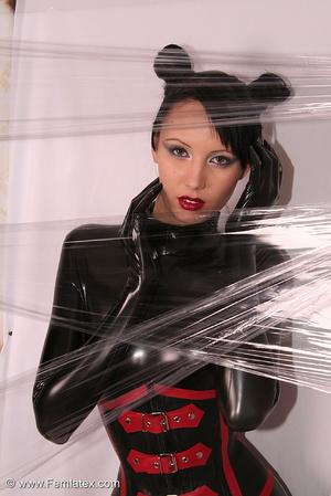 Sexy brunette in black latex jumpsuit ta - XXX Dessert - Picture 5
