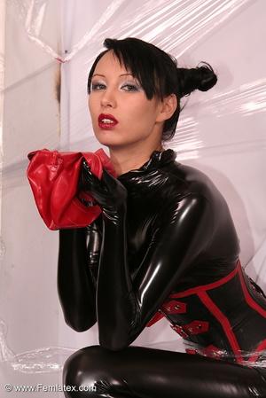 Sexy brunette in black latex jumpsuit ta - XXX Dessert - Picture 8