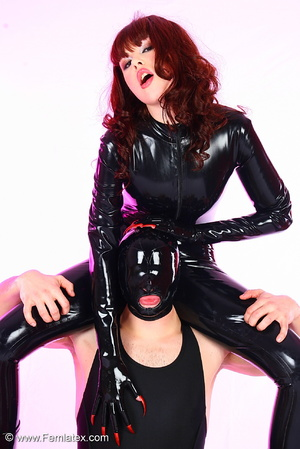 Young couple in black latex posing with  - XXX Dessert - Picture 1