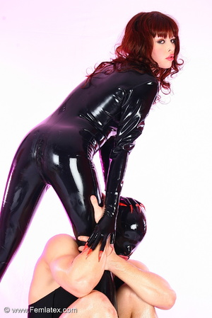 Young couple in black latex posing with  - XXX Dessert - Picture 3