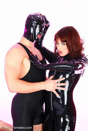 Young couple in black latex posing with  - XXX Dessert - Picture 6