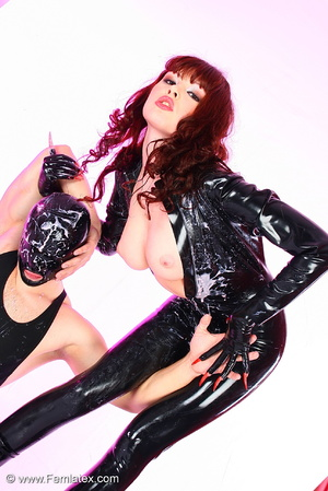 Young couple in black latex posing with  - XXX Dessert - Picture 11