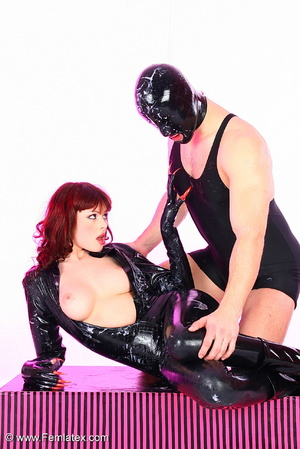 Young couple in black latex posing with  - XXX Dessert - Picture 12