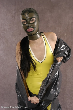 Masked girl in yellow latex comes out of - XXX Dessert - Picture 3