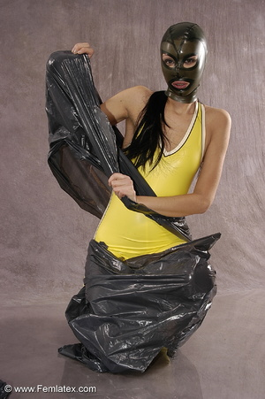 Masked girl in yellow latex comes out of - XXX Dessert - Picture 5