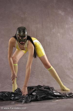 Masked girl in yellow latex comes out of - XXX Dessert - Picture 9