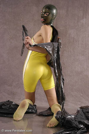 Masked girl in yellow latex comes out of - XXX Dessert - Picture 12