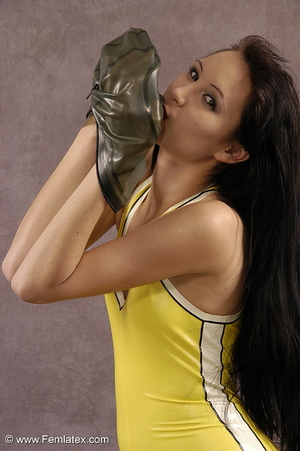 Masked girl in yellow latex comes out of - XXX Dessert - Picture 16