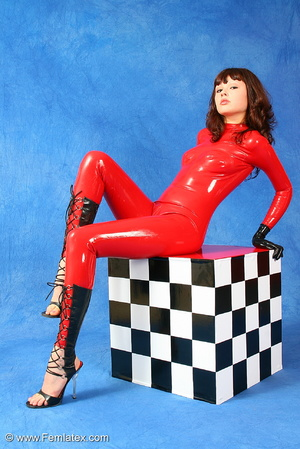 Brunette bombshell in red latex jumpsuit - XXX Dessert - Picture 1