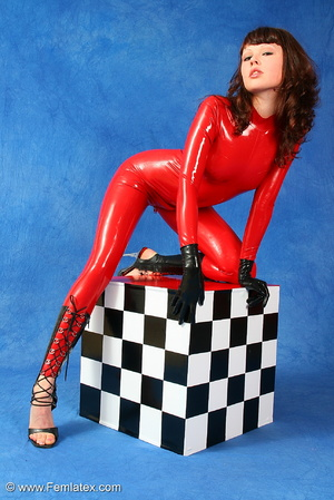 Brunette bombshell in red latex jumpsuit - XXX Dessert - Picture 2