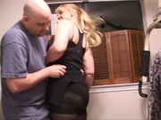 dutiful blond wife greets