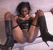 Sensual ebony mama spread legs wide apart on sofa to get her butt screwed