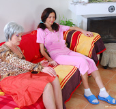 Strict mom punishes bad girl with spanking and drives her into hot lesbian