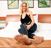Slutty blonde tempting with her delicious feet in sexy tan nylons