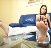Beautiful bitch shows her sexy soles and long toes