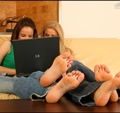 Two bare foot beauties charm with their lovely feet and lickable toes