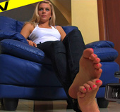 Hot blonde bitch teases while rubbing her soles together