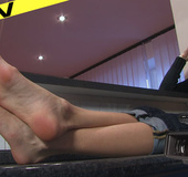 Sexy demure bitch rubs her toes slowly
