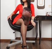 Lovely brunette displays her slender pantyhosed feet