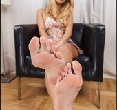Slutty blonde shows her long legs and slender feet with long suckable