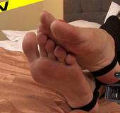 Sexy brunette rubbing her bare soles