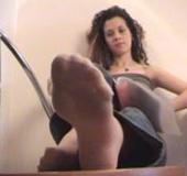 Slutty babe shows her pretty sexy feet in grey nylon socks