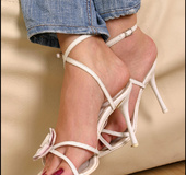 Slim long and elegant feet ready for sensual seduction