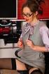 Slutty secretary in stockings and glasses undresses for her boss