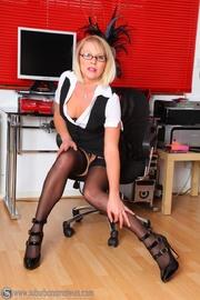 blonde secretary glasses shows