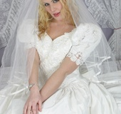 Blonde bride in a dress and stockings toying her cunt before her wedding