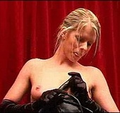 Nasty blonde in ponytail in bdsm latex suit with a whip fingering her