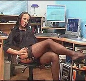 Slutty brunette secretary in stockings playing with her vibro in her work