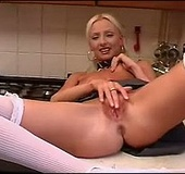 Pigtailed MILF in white stockings wanking off in the kitchen