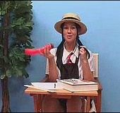 Brunette chick in a school uniform and a hat playing with a vibro