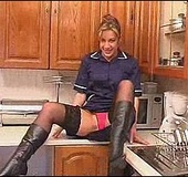 Nasty mom in high boots and stockings showing off her stretched cunt