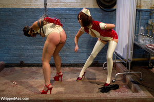 Naughty nurse ties up patient and whips, - Picture 2