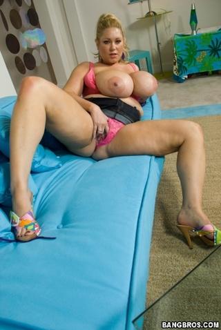 Busty milf works her hard nipples 5