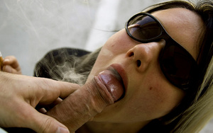 Teen Aneta in sunglasses smokes while li - XXX Dessert - Picture 1