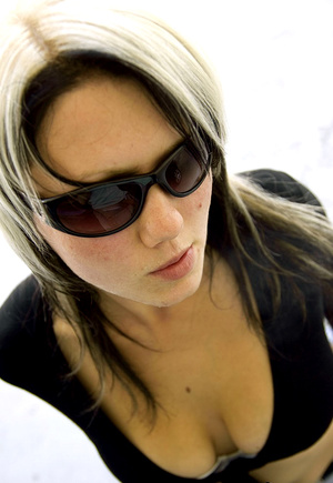 Teen Aneta in sunglasses smokes while li - XXX Dessert - Picture 4