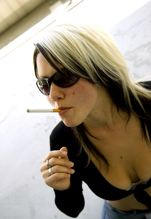 Teen Aneta in sunglasses smokes while li - XXX Dessert - Picture 5