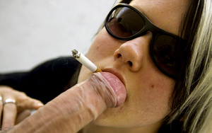 Teen Aneta in sunglasses smokes while li - XXX Dessert - Picture 9