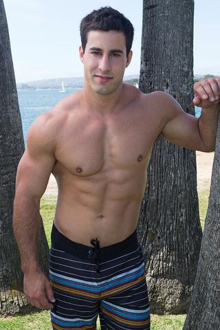 muscular brunette guy exposing