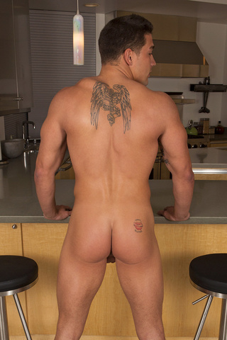 muscular tattooed dude exposing