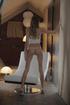 Slim teen girl in white lingerie exploring her body