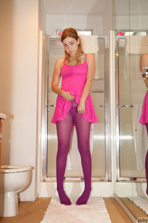 Lovely red-headed gal posing in purple t - XXX Dessert - Picture 1