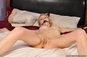 With a shaved pussy, naked submissive blonde squirming as she is tied spread eagle on the bed - XXXonXXX - Pic 9