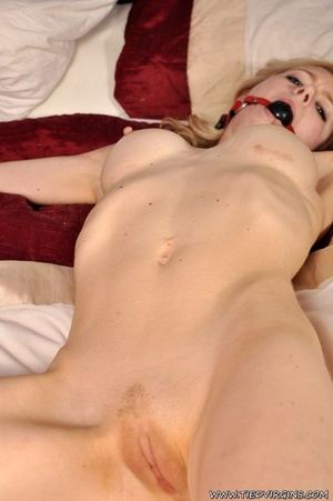 With a shaved pussy, naked submissive blonde squirming as she is tied spread eagle on the bed - XXXonXXX - Pic 11